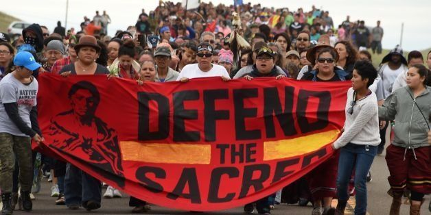Native Americans march to the site of a sacred burial ground that was disturbed by bulldozers building the Dakota Access Pipe
