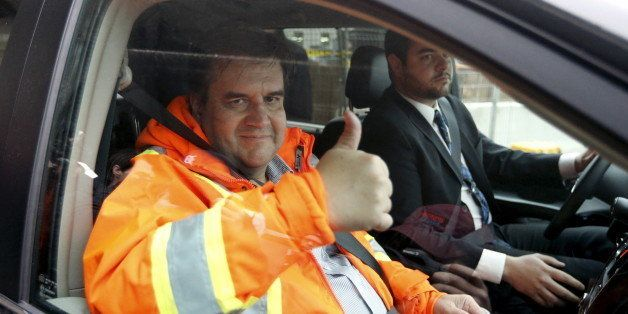 Montreal Mayor Denis Coderre gives a thumbs up after inspecting ongoing work of a sewer in Montreal November 12, 2015. Montre