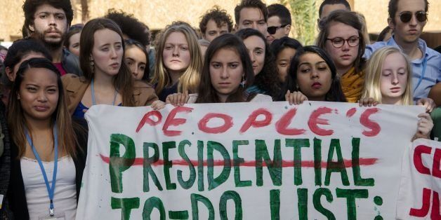 American students protest outside the UN climate talks during the COP22 international climate conference in Marrakesh in reac