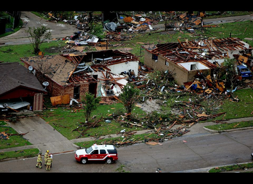 Emergency personnel work the scene after a tornado hit a neighborhood in Kennedale, Texas on Tuesday, April 3. Tornadoes tore