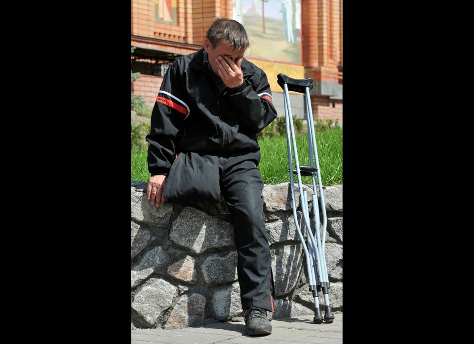 A disabled man cries at the Chernobyl victims memorial in Kiev during a memorial ceremony on April 26, 2012. Ukraine launched