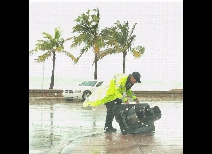 "A safety aide moves a fallen traffic light in Fort Lauderdale, Fl. (CREDIT: Instagram user <a href=""http://ipv6.statigr.am/p/"