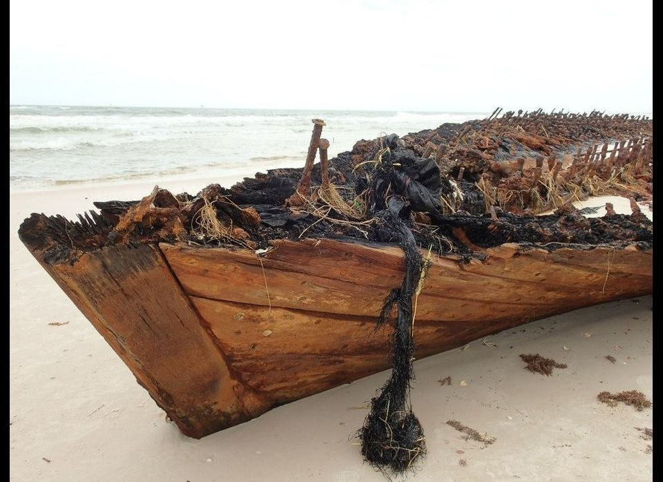 "Photos showing a shipwreck on an Alabama beach uncovered by Hurricane Isaac. <a href=""https://www.facebook.com/MeyerVacationR"