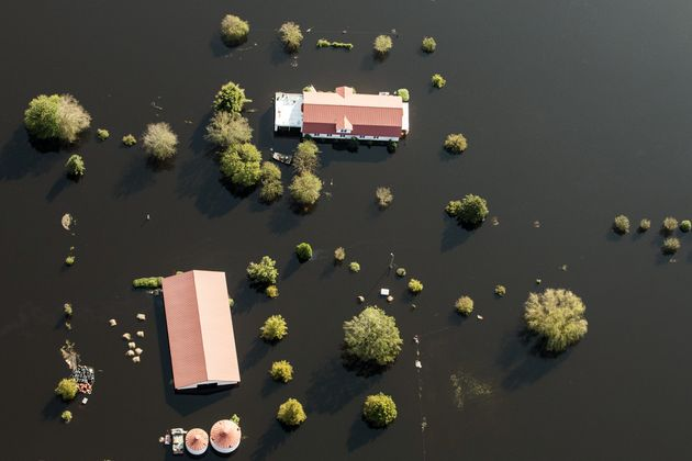 A hog farm surround by floodwater is seen in this aerial photograph taken above New Bern, North Carolina,...