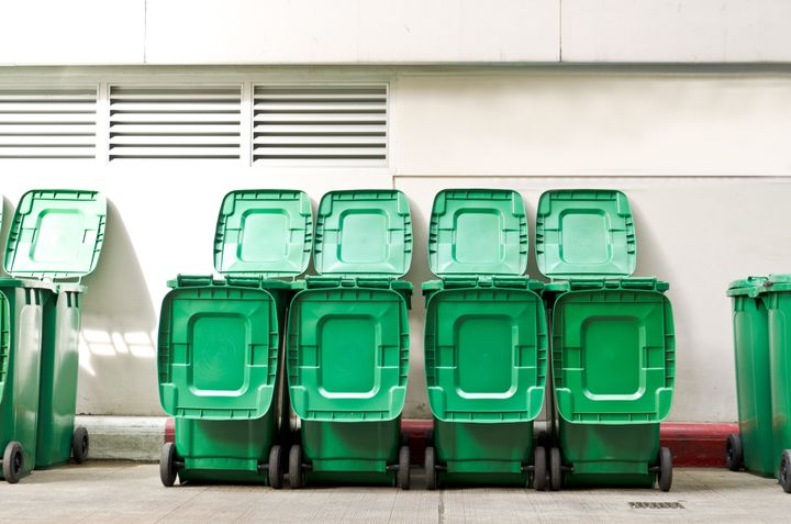 large green trash cans garbage ...
