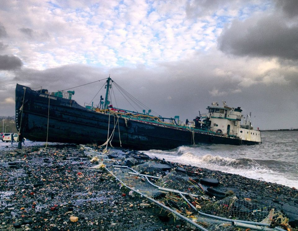 A 168-foot water tanker, the John B. Caddell, sits on the shore Tuesday morning, Oct. 30, 2012 where it ran aground on Front