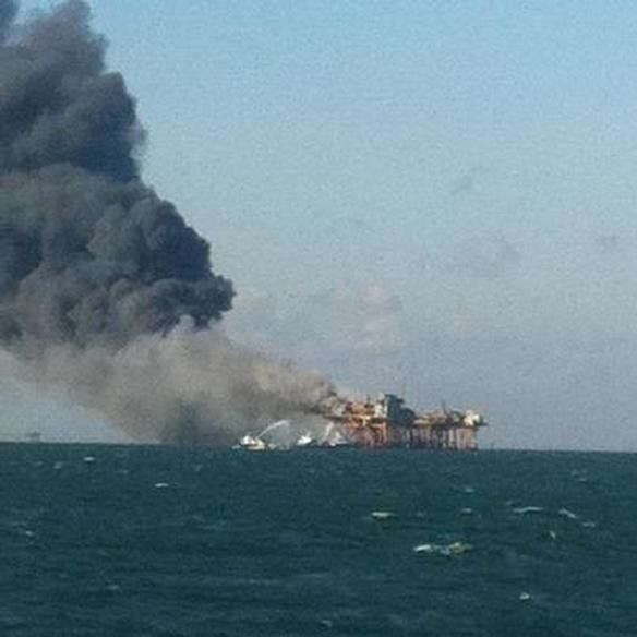 Viewer submitted photo from KATC shows a burning oil platform off the coast of Grand Isle, La., Friday Nov. 16, 2012. The exp
