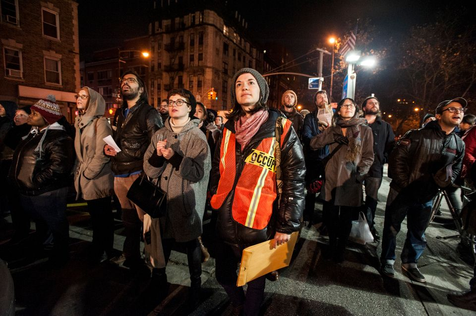 """Crowds watch a short film called """"Occupy Sandy: A Human Response to the New Realities of Climate Change"""" that was projected o"""