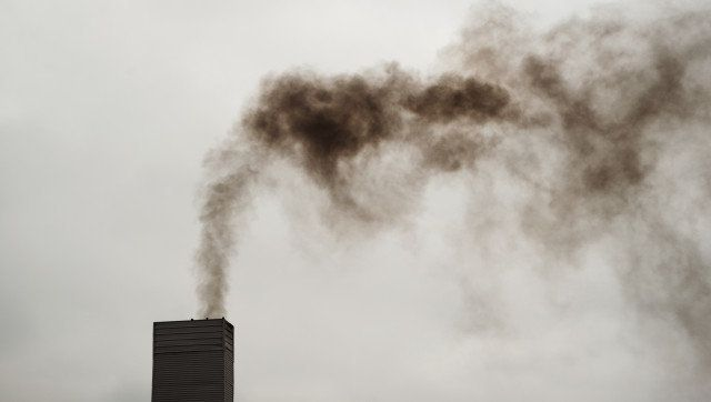 dark black smoke from the...