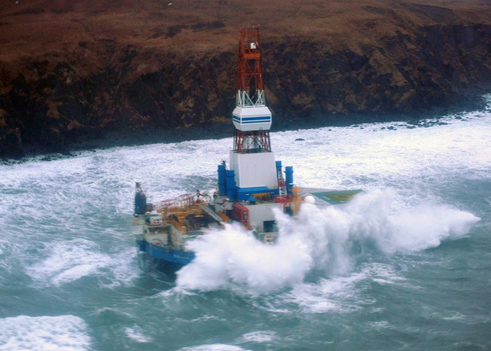 This image provided by the U.S. Coast Guard shows the Royal Dutch Shell drilling rig Kulluk aground off a small island near K