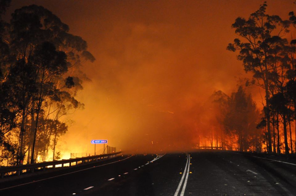 In this photo provided by the New South Wales Rural Fire Service a wildfire near Deans Gap, Australia, crosses the Princes Hi