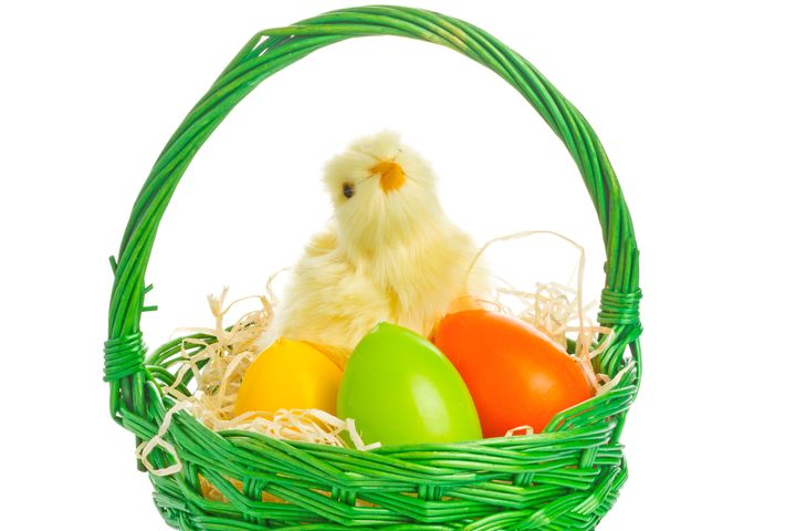 basket with easter eggs and...