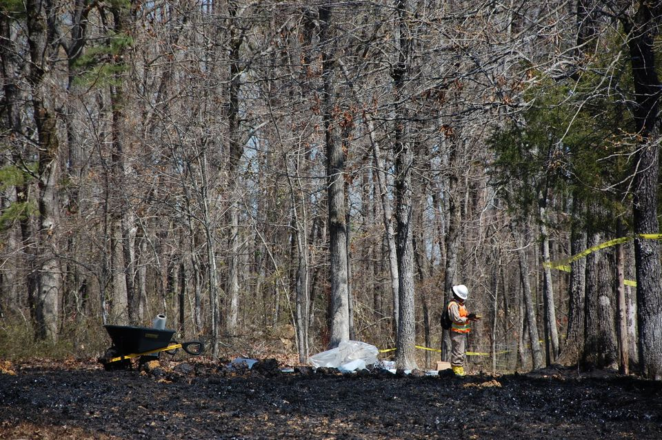 Workers clean up oil in Mayflower, Ark., on Monday, April 1, 2013, days after a pipeline ruptured and spewed oil over lawns a