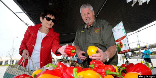 TORONTO, ON - MAY 3: Deborah Couz (left) helps to run the market and is seen getting schooled on the finer points of pepper s