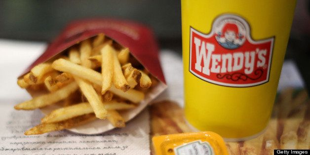 A customer's meal of French fries and a soft drink sit on a tray inside a Wendy's fast food restaurant in Moscow, Russia, on