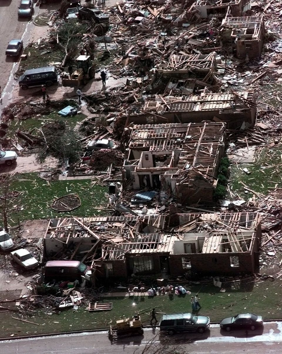 A neighborhood in Moore, Okla., lays in ruins pm Tuesday, May 4, 1999, after a tornado flattened many houses and buildings in