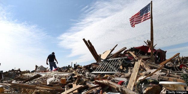 MOORE, OK - MAY 23:  Stan Mallette searches through the rubble of his son's home on May 23, 2013 in Moore, Oklahoma. The torn