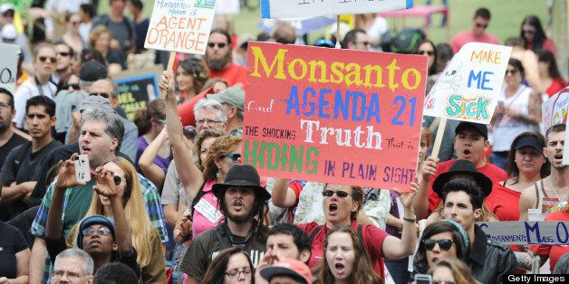 People carry signs during a protest against agribusiness giant Monsanto in Los Angeles on May 25, 2013. Marches and rallies a