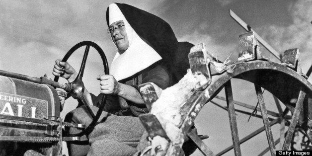 Sister Mary Othelia drives one of the Mount Asissi Convent's tractors across the fields where the nuns do all of the planting