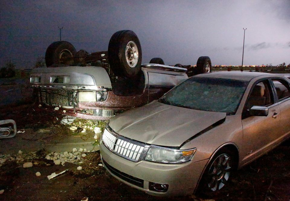 Cars that were damaged by a tornado in parking lot at Canadian Valley Technical Center on State Highway 66, west of Banner Ro