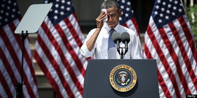 WASHINGTON, DC - JUNE 25:  U.S. President Barack Obama wipes sweat off his face as he unveils his plan on climate change June