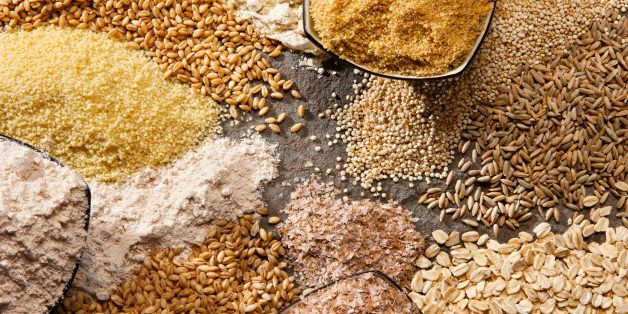 Piles of organic whole grains in different forms.