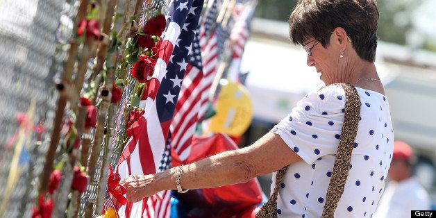 Nancy Alder pays her respects at the memorial for the 19 fallen Granite Mountain Hotshot firefighters outside of fire station