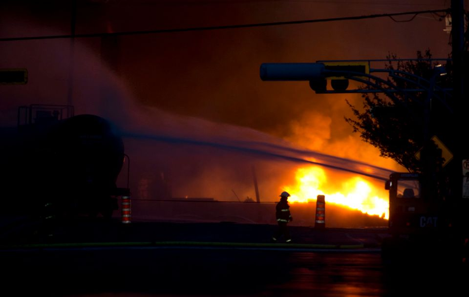 A fire keeps burns after railway cars that were carrying crude oil derailed in downtown Lac Megantic, Quebec, Saturday, July