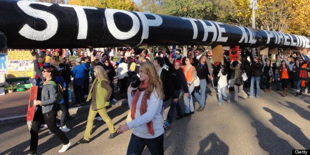 Thousands of protesters encircled the White House in Washington, D.C., Sunday, November 6, 2011, to demonstrate against the p