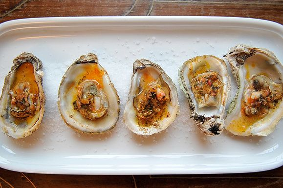 "<strong>Get the <a href=""http://food52.com/recipes/2882-grilled-or-broiled-oysters-with-a-sriracha-lime-butter"" target=""_blan"