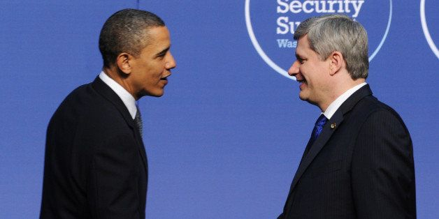 Canadian Prime Minister Stephen Harper shakes hands with US President Barack Obama as he arrives for a dinner during the the Nuclear Security Summit April 12, 2010 in Washington, DC. AFP PHOTO / JEWEL SAMAD (Photo credit should read JEWEL SAMAD/AFP/Getty Images)