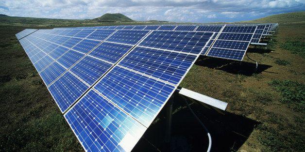 Hawaii, Big Island, Kamuela, Parker Ranch, Solar panels in open field.
