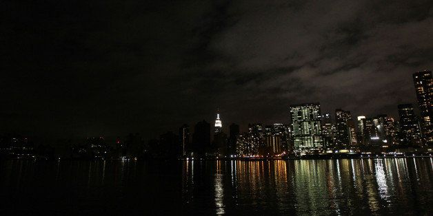 The darkened skyline of lower Manhattan is seen one day after Hurricane Sandy on October 30, 2012.  Life ground to a virtual