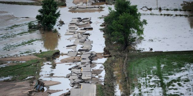 GREELEY, CO. - SEPTEMBER 16:  a section of U.S.34 outside Greeley is crumbled into pieces in the flood waters. Aerial photogr