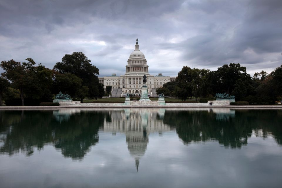 Storm clouds hang over Capitol Hill in Washington, Friday, Sept. 27, 2013, as the Republican-controlled House and the Democra