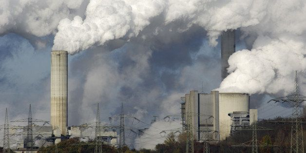Part of a coal burning power plant with pollution.