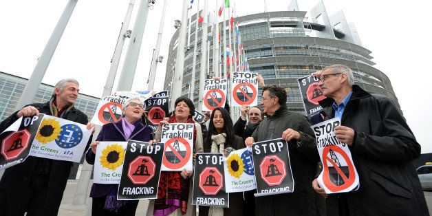 Members of the Greens/European Free Alliance group of the European Parliament hold banners reading 'stop fracking' before a v