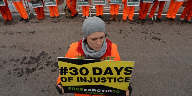 Greenpeace activists holds posters with pictures of the 'Artic 30' detained Greenpeace activists  as they demonstrate in Mosc