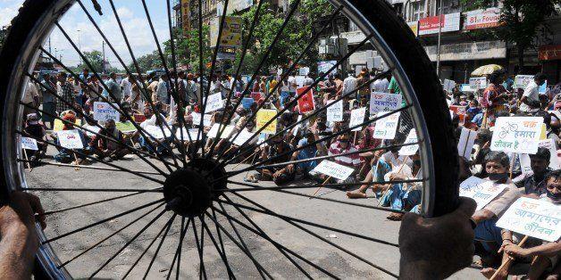 KOLKATA, INDIA - OCTOBER 2: Satyagrahis demanding return of 'Chakra' to street on Gandhi Jayanti, the occasion of 144th birth
