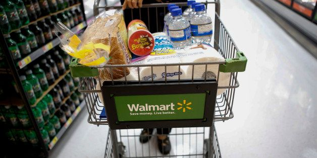 A customer pushes a shopping cart during the grand opening of a Wal-Mart Stores Inc. location in the Chinatown neighborhood o