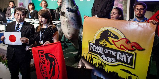 Action Network (CAN) activist is seen during CAN press conferance at United Nations Climate Change COP19 as she announces tha