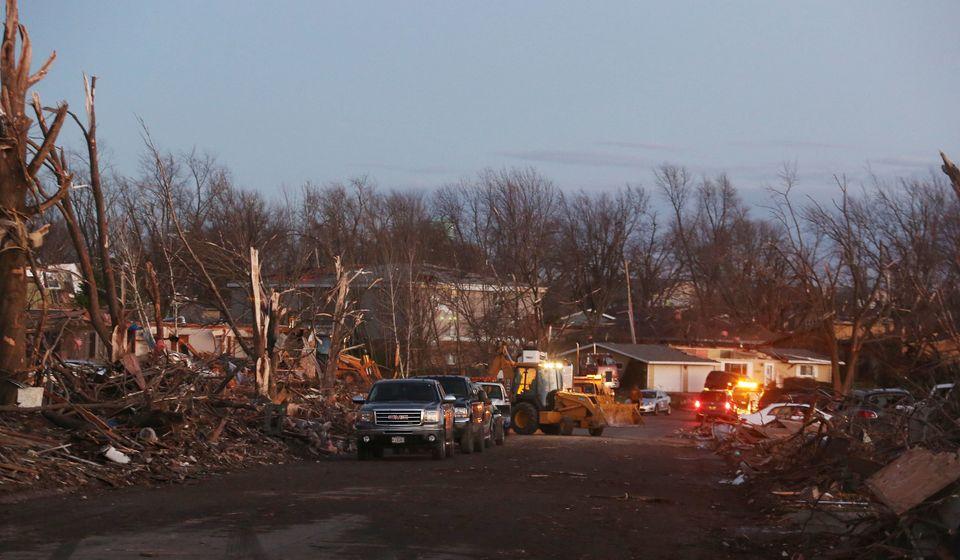 WASHINGTON, IL - NOVEMBER 17: The damage is surveyed along Elgin Avenue after a tornado struck on November 17, 2013 in Washin