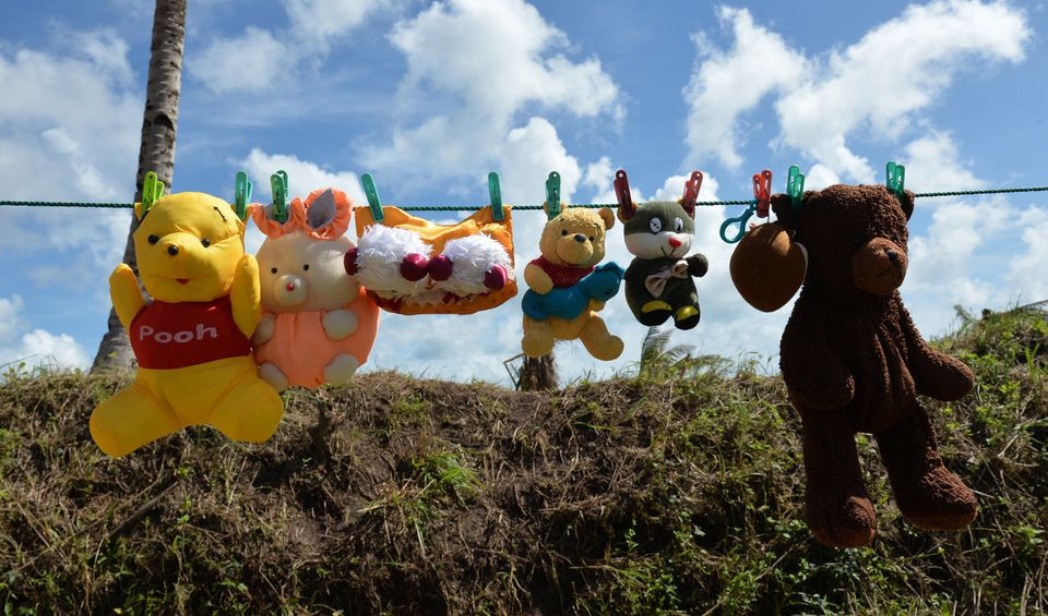 Stuffed toys are placed on a clothes line for drying along a road in Quinapundan town, Eastern Samar province, central Philip