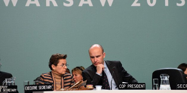 Poland's former Environment Minister, COP President Marcin Korolec and Christiana Figueres (L), Executive Secretary of the United Nations Framework Convention on Climate Change attend the 19th conference of the United Nations Framework Convention on Climate Change COP19 in Warsaw on November 22, 2013. The UN climate change conference that is to lay the groundwork for a new pact to prevent global warming, is scheduled to close Friday. AFP PHOTO / JANEK SKARZYNSKI (Photo credit should read JANEK SKARZYNSKI/AFP/Getty Images)
