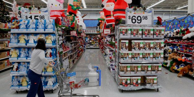 A customer shops holiday decorations for sale at a Wal-Mart Stores Inc. location ahead of Black Friday in Los Angeles, Califo