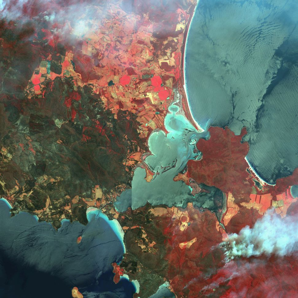 This is a satellite image of wildfires in Dunalley, Tasmania, Australia, collected on Jan. 6, 2013. (Photo DigitalGlobe via G