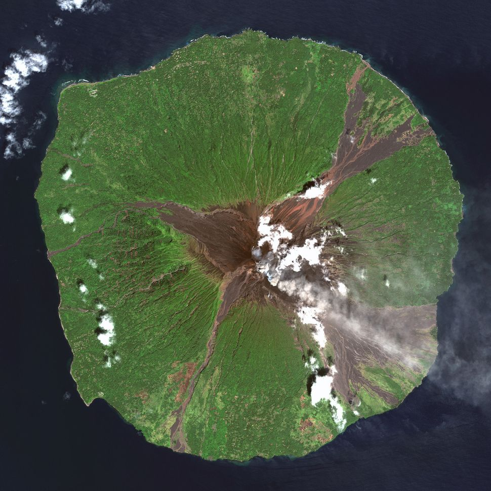 This is a satellite image of Manam Volcano, Madang Province, Papua New Guinea, collected on March 22, 2013. (Photo DigitalGlo