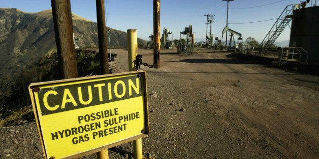 LOS PADRES NATIONAL FOREST, CA - AUGUST 4:  A sign warns of possible hydrogen sulphide gas near oil rigs outside the Sespe Co