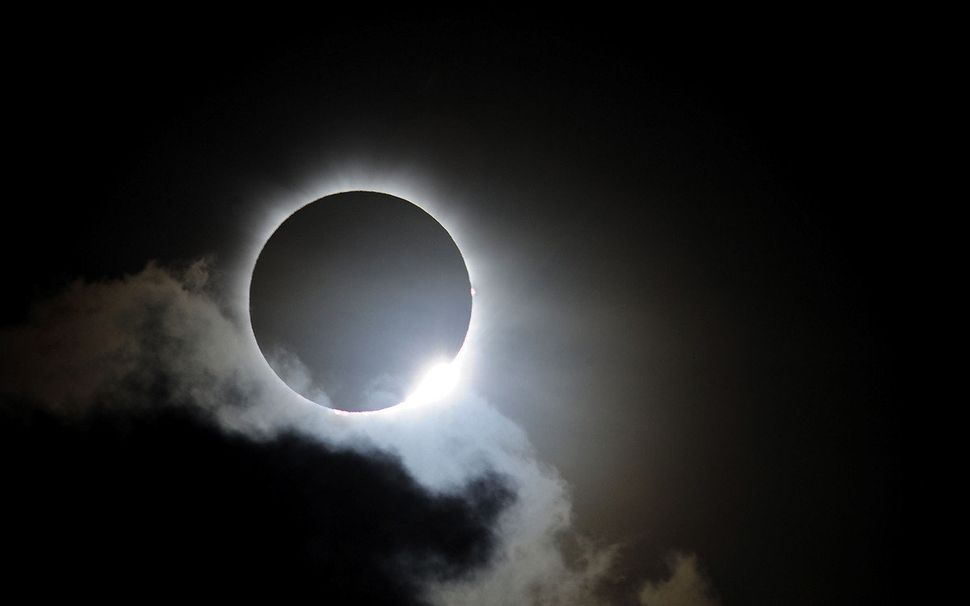 Near totality is seen during the solar eclipse at Palm Cove on November 14, 2012 in Palm Cove, Australia. Thousands of eclips