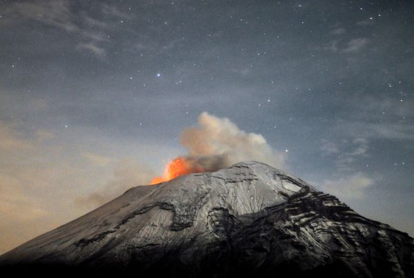 A cloud of ash belches out of Mexico's Popocatepetl volcano, some 55 km from Mexico City, as seen from Paso de Cortes, in the